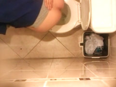 Hidden cam in public toilet ceiling