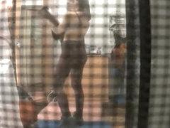 Spy camera catches neighbor in her bedroom undressing