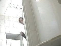 A juicy brunette caught by a spy camera pissing in a public toilet
