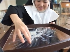 Nun receives a tribute and eats it