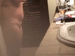 Mature wife spied in bathroom smoking and drinking