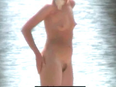 Hot blonde shows her naked hairy pussy on the beach