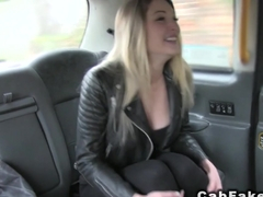 Busty blonde Brit gives footjob in fake cab