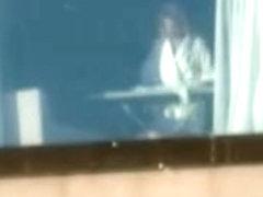 Spying hotel room window