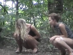 Gorgeous blonde girl pisses with a friend