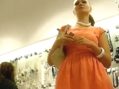 Classy blonde woman upskirted in store