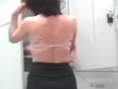 Changing room voyeur video with slim brunette girl