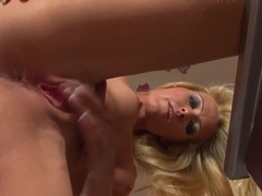 Model-quality lady Sophie Moone working manually her beautiful pussy