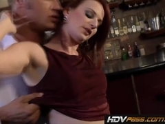 Petite redhead cougar Audrey Lords fucks in a Bar