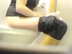 Blonde spied peeing in toilet