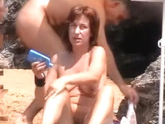 Nudist woman in her daily life in beach
