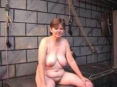 Old wench's bawdy wazoo goes red from spiked glove flogging in dungeon