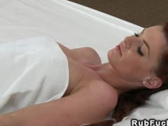 Busty redhead massaged and fingered