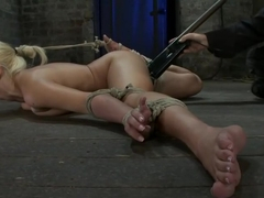 Former Romanian Gymnast puts her flexibility to the test as she is brutally bound on the floor.
