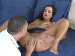 Sexy Lisa Ann spreads her legs as she enjoys her pussy being licked