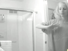 Hidden bathroom cam video of a blonde with tiny titties