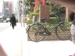 Asian babe got skirt sharking in front of her mailbox.