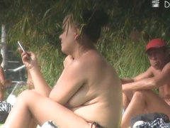 Hidden camera films beach nudist women tanning their bodies and big tits