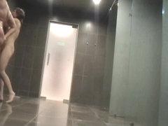 Shower voyeur action of fem scouring her body skin