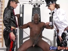 Latex dominas tug black cock