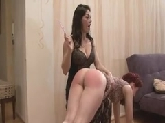 Redhead life coach spanked by Brunette