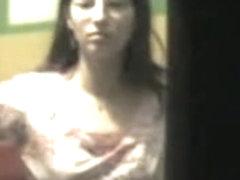 Hot strip of the babe voyeured through the window