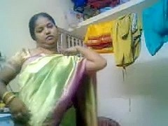 Tamil woman stripping to disclose her breast