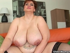Voluptuous old woman with massive boobs copulates a marital-device