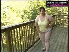 BBW works her fat pussy on balcony 1