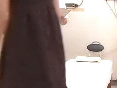 Pretty Asian enjoys some masturbation during erotic massage