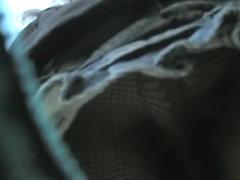 Amazing fishnet pantyhose up the skirt closeups