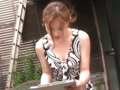 Spy cam downblouse video of a skinny Asian in a black & white dress