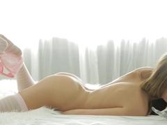 porn art video showing Tini sucking a big dildo