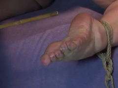 Olga gets tied and dominated by a wooden stick