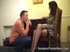 Business woman in nylons facesitting