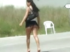 Hoe on the street in miniskirt flashing ass