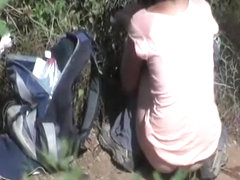 Woman pissing outdoors