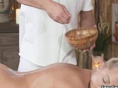 Muscular masseur fucks blond slut on massage table
