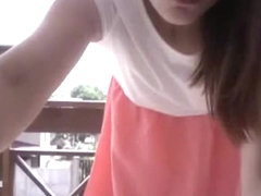 Hot girl plays with herself on the balcony of her apartment