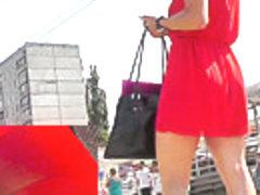 Brunette coquette's hot red dress presents upskirt view
