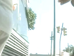 Up skirt at bus stop with sexy mature chick