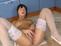 Oiled up babe white fishnet stocking masturbation