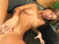 A tanned hottie has all of her holes opened wide by a big hard cock