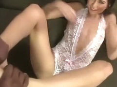 Riley Reid gives a superb footjob to a black cock