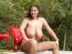 Sexy temptress with great big natural boobs Eva Notty plays with her pussy in the water