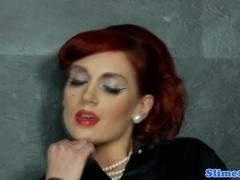 Glamorous gloryhole redhead in pantyhose