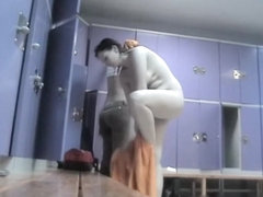 Amateur is toweling and creaming nude body in change room