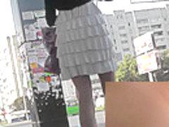 Pretty upskirt panties covering her hot buttocks