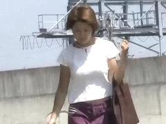 Hot Asian milf gets a nasty skirt sharking on a sunny day.