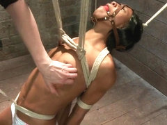 Tiny Nikki Darling gets greased up contorted and pussy pounded